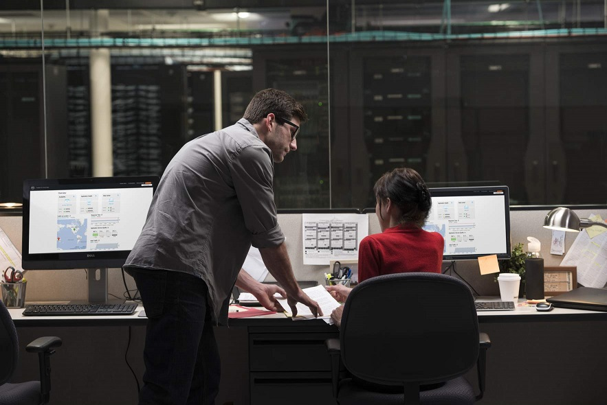 Man and Woman At Desk Using OptiPlex 9020 AIO Touch and P2414 H